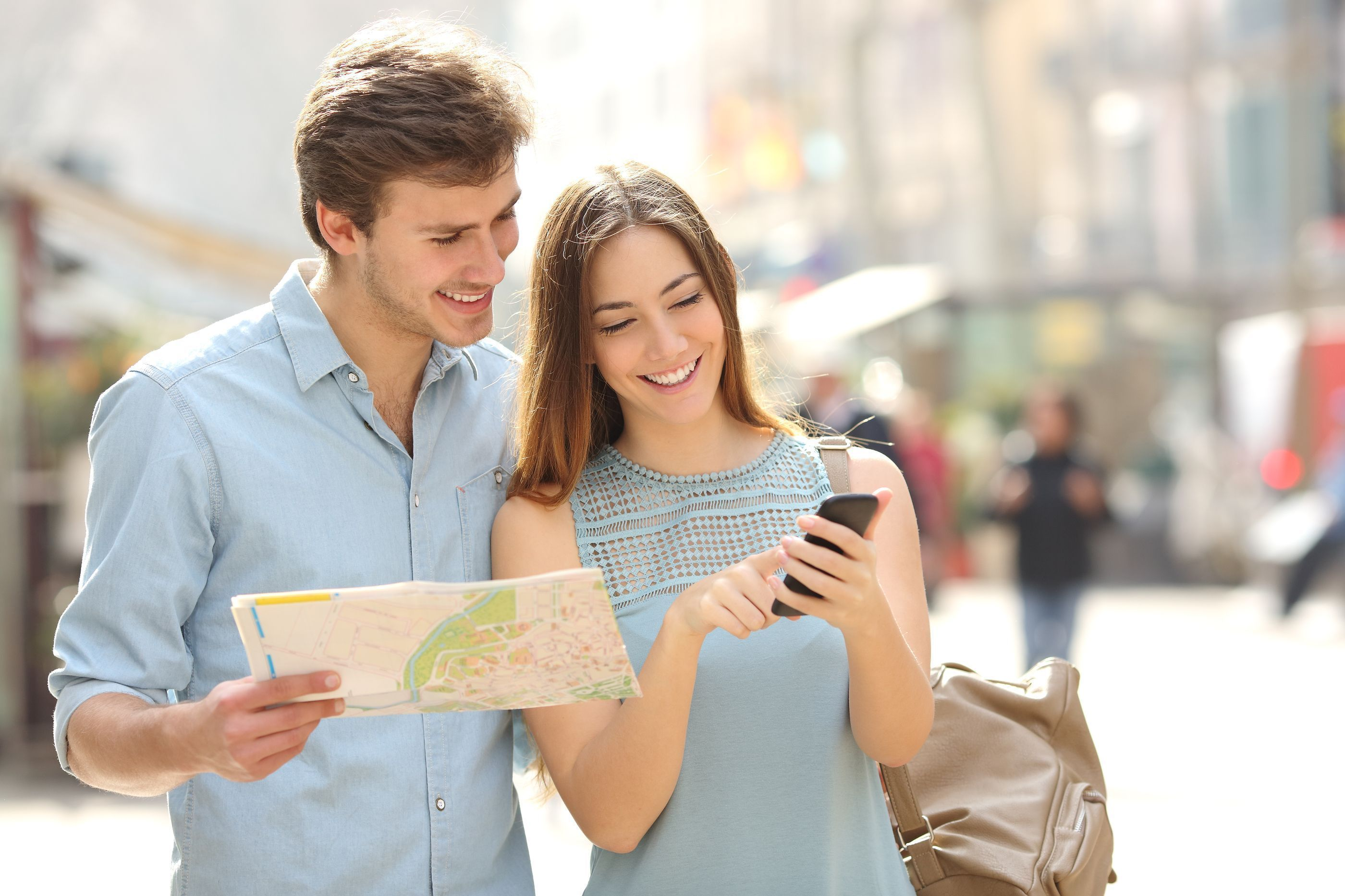 bigstock-Couple-Of-Tourists-Consulting-85806185.jpg