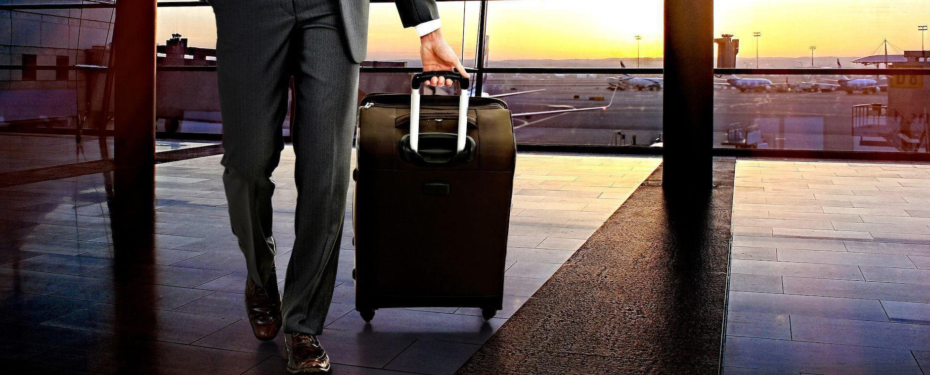 bigstock-Business-man-with-suitcase-in-116977547.jpg