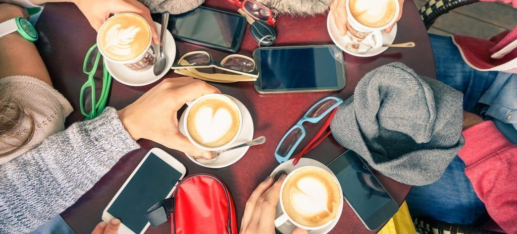 Group Of Friends Drinking Cappuccino At Coffee Bar Restaurants - People Hands With Smartphones
