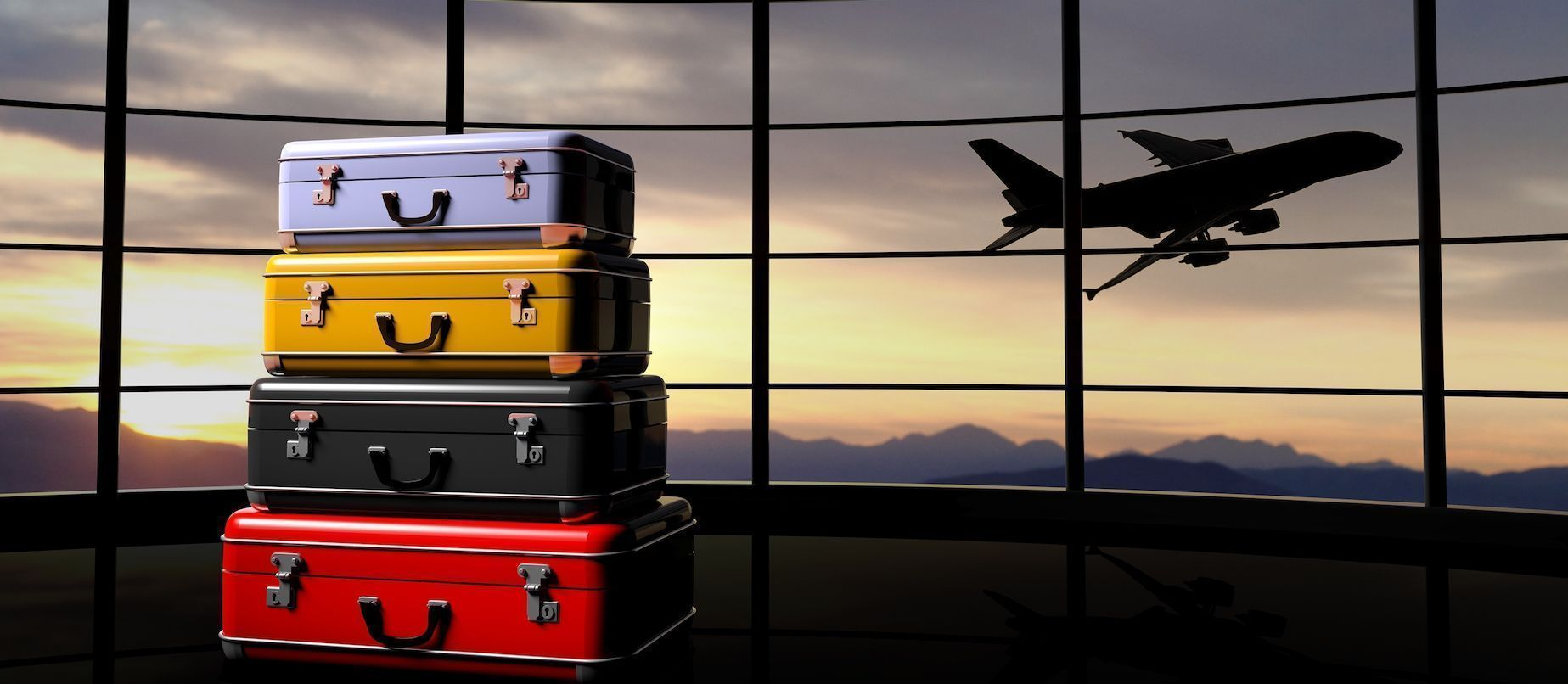bigstock-Stack-of-suitcases-beside-airp-96098975.jpg