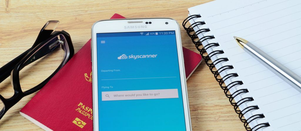 KOTA KINABALU MALAYSIA - JULY 1 2016: Skyscanner on mobile app it help you find cheap flights and airline tickets to your favorite travel destinations so much easier.
