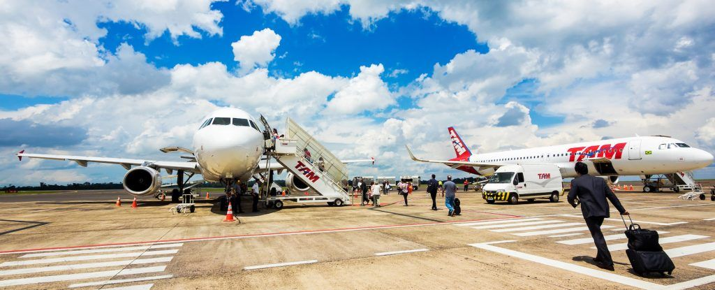 Foz do Iguacu, Brazil - Circa December, 2015: Passengers boarding Tam Airlines Airbus 320 airplane at Cataratas International Airport in Foz do Iguacu, Brazil. TAM is the Brazilian brand of Latam Airlines and the largest Brazilian airline.