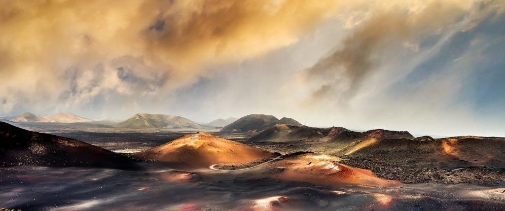 beautiful mountain landscape with volcanoes in at sunset Timanfaya National Park in Lanzarote, Canar