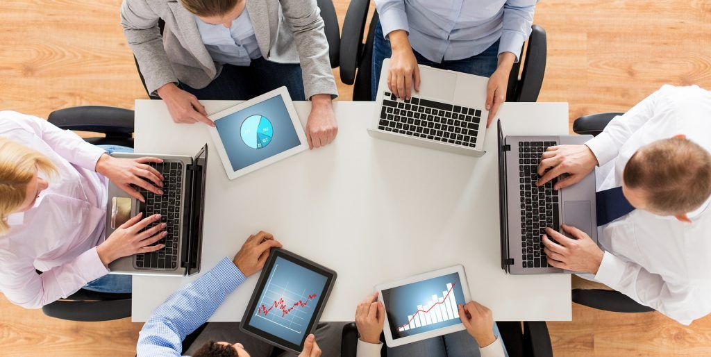 business, people and technology concept - close up of creative team with laptop and tablet pc comput