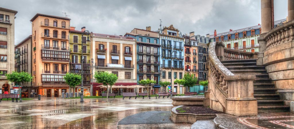 Colorful houses on Plaza del Castillo in rainy day Pamplona Navarra Spain
