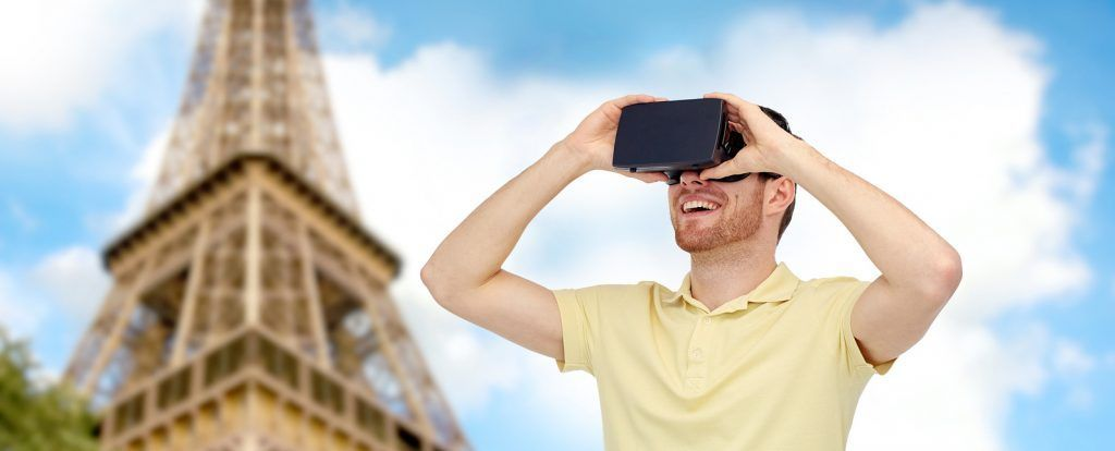 3d technology, virtual reality, travel, entertainment and people concept - happy young man with virt