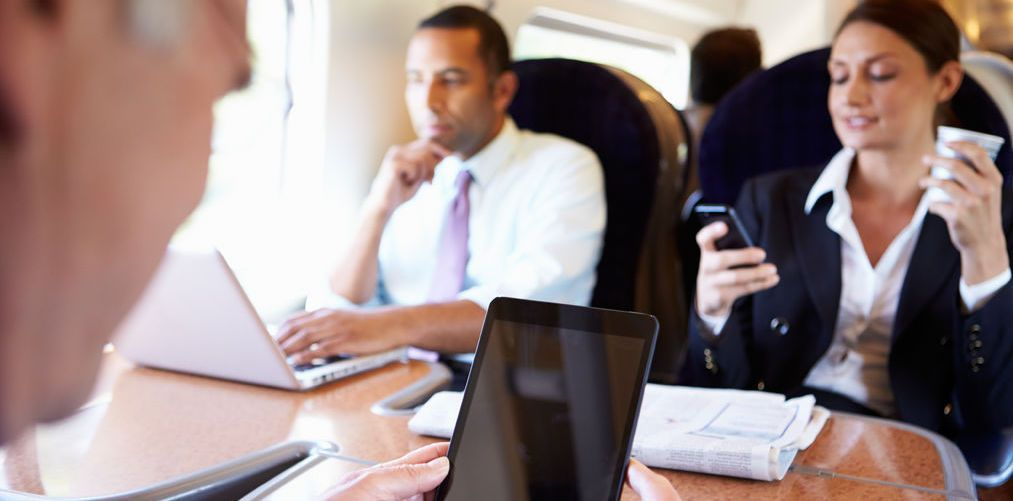 Businesspeople On Train Using Digital Devices-3