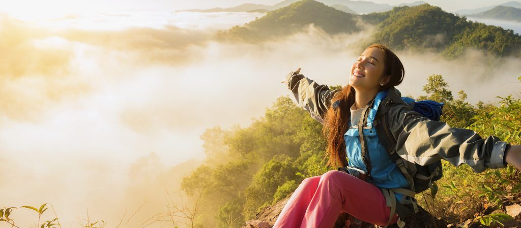 500px Photo ID: 236010129 - The adventurer stands at the top of the mountain with foggy morning sky with the shadow of a distant mountain,freedom lifestyle concept traveller with backpacks relaxing.