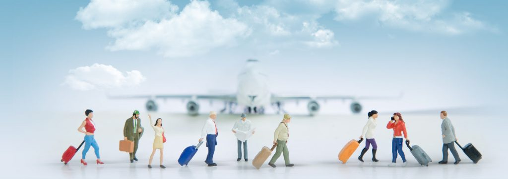 Travelling concepts. Group of traveler miniature
