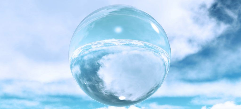 3D render of a glass sphere in the clouds