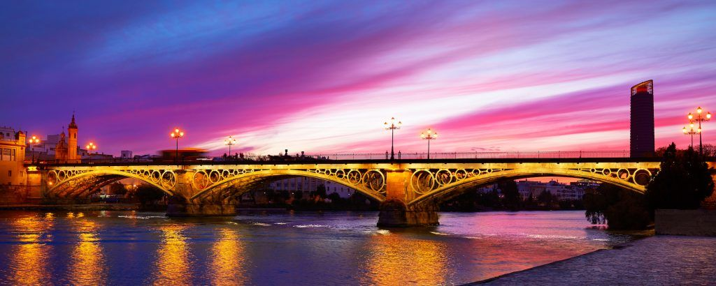 Puente Isabel II bridge in Triana Seville sunset of Andalusia Spain