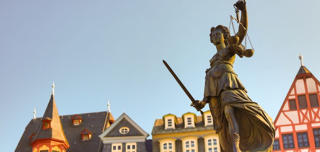 Old town square Romerberg with Justitia statue in Frankfurt Main, Germany with clear sky.