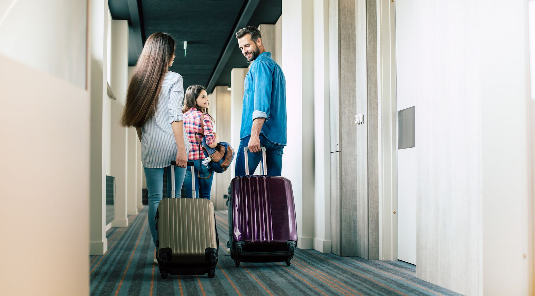 happy-family-carrying-suitcases-together.jpg