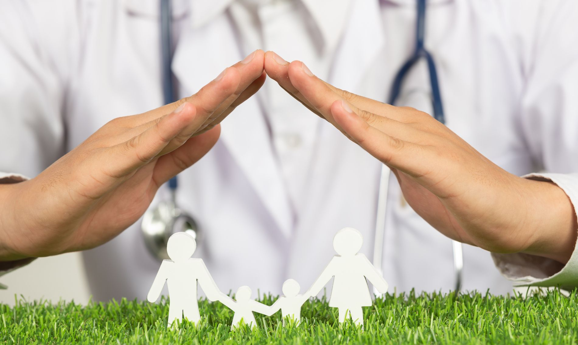 close-up-picture-of-doctor-s-hands-posting-symbol-of-home-above-family-member-model.jpg
